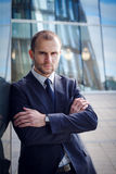 Portrait of serious businessman. On a background of office building Stock Photography