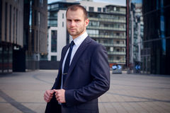 Portrait of serious businessman. On a background of office building Stock Images