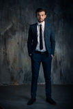 Portrait of a serious businessman in blue suit Royalty Free Stock Photo