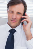 Portrait of a serious businessman talking on phone Royalty Free Stock Images