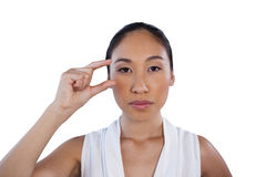 Portrait of serious businesswoman adjusting invisible eyeglasses Royalty Free Stock Photography