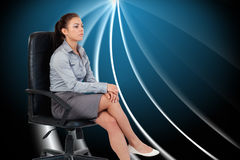 Portrait of a serious businesswoman sitting on an armchair Stock Images