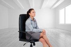 Portrait of a serious businesswoman sitting on an armchair Royalty Free Stock Photography