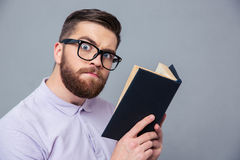 Portrait of a serious casual man holding book Royalty Free Stock Photos