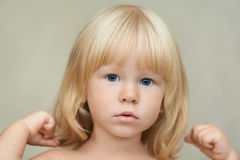 Portrait of a serious child Stock Photos