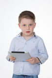 Portrait of serious child on white background Stock Image