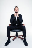 Portrait of serious concentrated business man in black office chair Stock Images