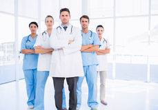 Portrait of serious confident group of doctors. Standing at the medical office Stock Image