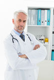 Portrait of a serious confident male doctor at medical office Stock Photo