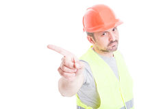 Portrait of serious constructor making refuse gesture with index. Portrait of serious constructor making refuse or no gesture with index finger isolated on white Royalty Free Stock Image