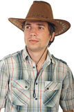Portrait of serious cowboy. Portrait of serious young cowboy with hat looking away isolated on white background Royalty Free Stock Photo