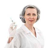 Portrait of serious doctor woman holding syringe Royalty Free Stock Photos