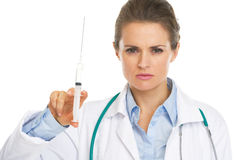 Portrait of serious doctor woman holding syringe Royalty Free Stock Images