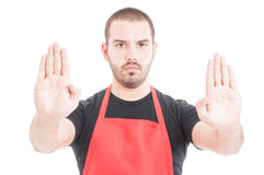 Portrait of serious employee doing stop sign Stock Image