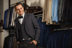 Portrait of serious fashionable handsome man in blue suit, Sexy man standing and looking at the camera Stock Images