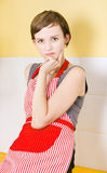 Portrait of a thinking cook on kitchen background Royalty Free Stock Photos
