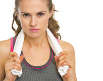 Portrait of serious fitness young woman with towel Royalty Free Stock Photos