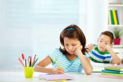 Schoolgirl at lesson Royalty Free Stock Images