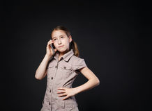 Portrait of serious girl speak on mobile phone Stock Images