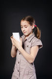 Portrait of serious girl touch screen on mobile phone Stock Photo