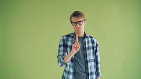 Portrait of serious guy shaking head and waving finger showing no gesture. Portrait of serious guy hipster shaking head and waving finger showing no gesture stock video