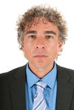 Portrait serious handsome adult man. With curly hair and formal suit Stock Photos