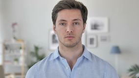 Portrait of Serious Handsome Young Man Looking at Camera stock video footage