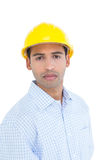 Portrait of a serious handyman wearing a yellow hard hat Stock Photo