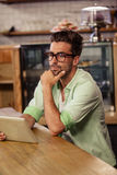 Portrait of serious hipster man using tablet Royalty Free Stock Images