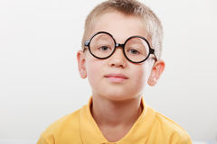 Portrait of serious kid little boy in glasses. Royalty Free Stock Images