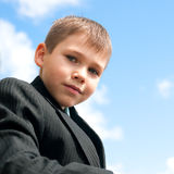 Portrait of a serious kid outdoors Stock Image