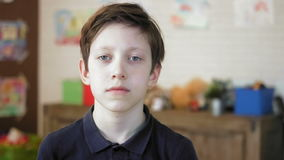 Portrait of a serious little boy looking at the camera stock footage