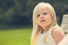Portrait of serious little girl in white dress Royalty Free Stock Photo