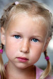Portrait of serious little girl Stock Images