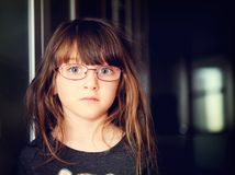 Portrait of serious little girl in glasses Stock Photos