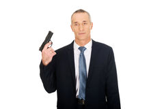 Portrait of serious mafia agent with handgun Stock Images
