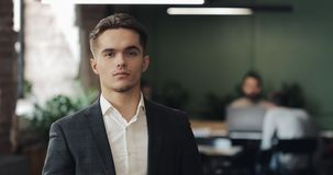 Portrait of serious male entrepreneur in a modern shared workplace. Business, Finance, Founder, Success Concept stock video footage
