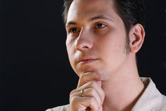 Portrait serious  man. Portrait of the serious young man on a black background Stock Images