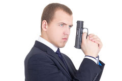Portrait of serious man in business suit with gun isolated on wh Stock Photo