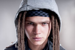 Portrait of serious man with dreadlocks. Royalty Free Stock Photo