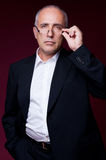 Portrait of serious man in glasses Stock Photo