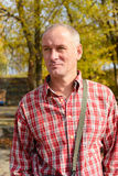 Portrait of a serious man in a plaid shirt Stock Photos