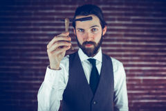 Portrait of serious man showing razor Royalty Free Stock Photography