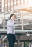 Portrait ofserious man talking on smartphone outdoors. caucasian businessman using mobile phone,making call on the street in city Royalty Free Stock Photos