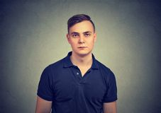 Portrait of a serious man. Portrait of a serious young man looking at camera isolated on gray Royalty Free Stock Images