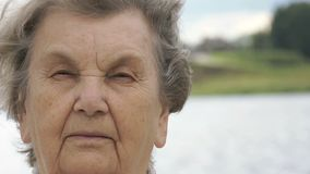 Portrait of serious elderly woman outdoors stock video footage