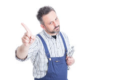 Portrait of serious mechanic doing no or refusal gesture. With copyspace isolated on white Stock Photos