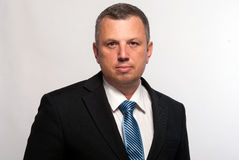 Portrait of a serious middle-aged man in a suit. stock photography