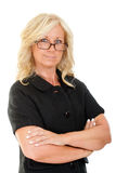 Portrait of serious middle aged woman in business attire Stock Photography