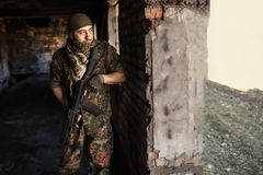 The Arab soldier with the AK-47 Kalashnikov assault rifle. Portrait of serious middle eastern man with AK-47 Stock Photo